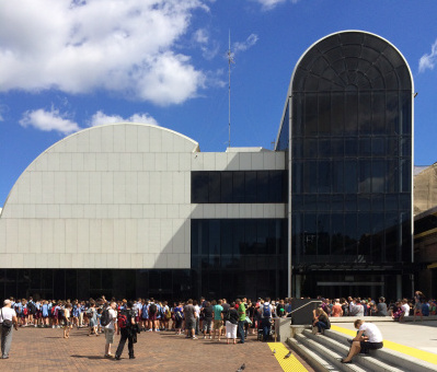Crowds building outside the Powerhouse Museum.